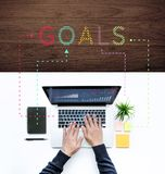 Goals with male using computer laptop. Business technology,communication and networking concepts ideas/top view Royalty Free Stock Images