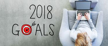 2018 Goals with man using a laptop. In a modern gray chair royalty free stock image
