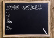 2016 goals. New chalkboard with 3D outlined text - on wood Royalty Free Stock Photo