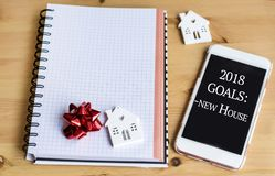 2018 Goals - New House Concept. Small White House and Smart Phone with 2018 Goals stock image
