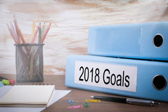 2018 goals, Office Binder on Wooden Desk. On the table colored pencils, pen, notebook paper.  Royalty Free Stock Image