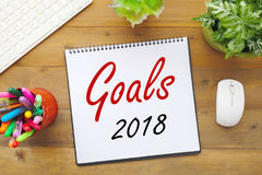2018 goals on paper note book background on office table, busine Stock Photos