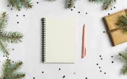 Goals plans dreams make to do list for new year 2018 christmas concept writing. In notebook pen gift fir brunches on white background. New year winter holiday royalty free stock photo