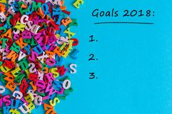 Goals 2018 text on blue background. New Year`s promises for the next year with to do list, Mock up.  Stock Image