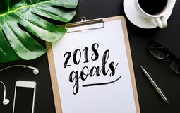 2018 goals text writing on notepaper and accessories