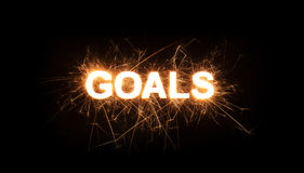 GOALS title word in glowing sparkler Royalty Free Stock Images