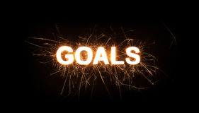 GOALS title word in glowing sparkler Stock Photos