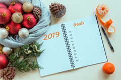 2019 goals. To do list in notepad next to Christmas decorations, cones and tangerines. royalty free stock images