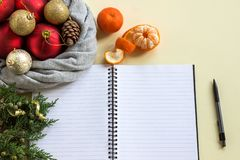 2019 goals. To do list in notepad next to Christmas decorations, cones and tangerines. stock photo