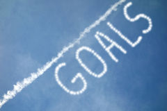 Goals. A white ascending line in the sky, and the word Goals stock image
