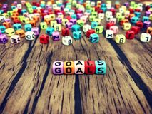 GOALS word of colourful cube alphabets. stock image