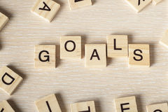 Goals word concept at wood background. Wooden ABC stock photography