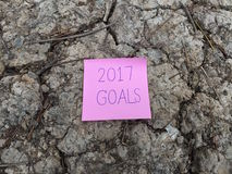 2017 Goals Word Written on Pink Sticky Note on Cracked Ground Background Stock Photo