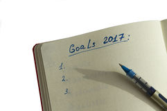 Goals for 2017 written in the organizer Stock Photos