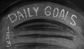 DAILY GOALS written on a used blackboard Royalty Free Stock Photos