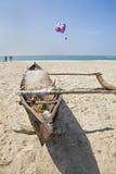 Goan fishing boat bathers and paragliders Stock Photo