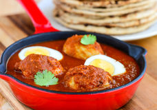 Goan meal-Egg curry and roti. Indian meal -egg curry and Indian flat bread roti for main course,lunch or dinner Stock Image