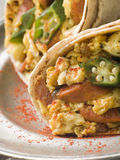 Goan Style Eggs wrapped in a Chapatti Stock Images