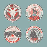 Goat badges color. Set of 2015 Chinese New Years symbol goat colored  logos design. Logotype templates and badges with goats, mountains, sun and stars. Product Royalty Free Stock Photography