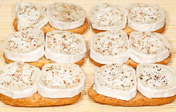Goat Cheese Appetizers. Snacks of bread and round slices of goat cheese Royalty Free Stock Image