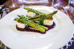 Goat cheese and asparagus dish Stock Photography