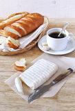 Goat cheese, baguette and coffee Stock Photos