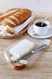 Goat cheese, baguette and coffee Royalty Free Stock Images