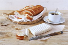 Goat cheese, baguette and coffee Royalty Free Stock Photo
