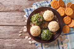Goat Cheese balls with crackers, herbs and pumpkin seeds. Horizo Stock Image