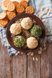 Goat Cheese balls with crackers, herbs and pumpkin seeds. vertic Royalty Free Stock Image
