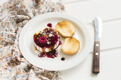 Goat cheese with berry sauce, balsamic vinegar and walnuts Stock Image