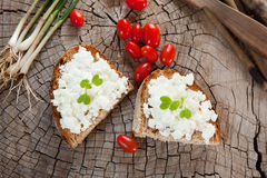 Goat cheese on bread. Soft goat cheese on bread or toast Royalty Free Stock Photography