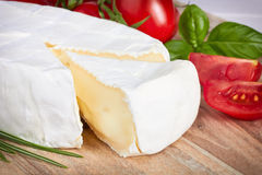 Goat cheese, cherry tomato, and herbs Stock Photos