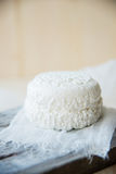 A goat cheese cut in half on a cutting board Royalty Free Stock Images