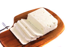 Goat cheese on cutting board Stock Photo