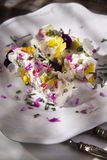 Goat cheese with edible flowers Stock Photos