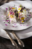 Goat cheese with edible flowers Royalty Free Stock Images