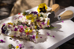 Goat cheese with edible flowers Royalty Free Stock Photography