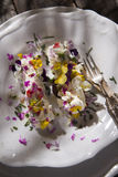 Goat cheese with edible flowers Stock Photo