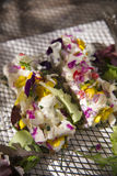 Goat cheese with edible flowers Stock Image