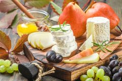 Goat cheese with fruit and honey Royalty Free Stock Image