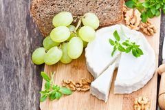 Goat cheese with fruits and whole grain bread stock images