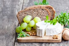 Goat  cheese  with fruits and whole grain bread. Goat  cheese with fruits and whole grain bread Stock Photos