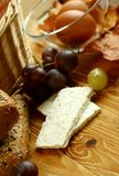Goat cheese and grapes on old wooden Stock Images