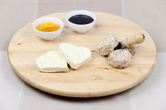Goat cheese heart shape, sesame seeds, jam Stock Image