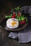 Goat cheese with honey and raspberries Stock Photo