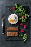 Goat cheese with honey and raspberries. Fresh goat cheese served on black slate board with honey, honeycomb, lavender, raspberries and green salad. With vintage Royalty Free Stock Images