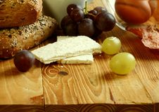 Goat cheese on old wooden Royalty Free Stock Image