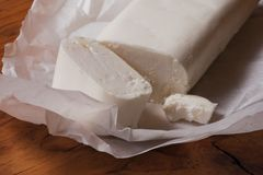 Goat cheese piece Stock Photography