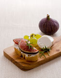 Goat cheese with ripe figs and grapes Stock Photo